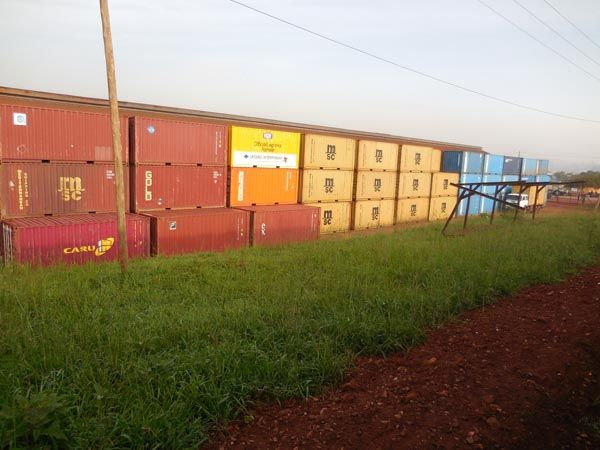 Freight containers near the railway's intersection with Kireka Road. Rift Valley Railways Kampala train