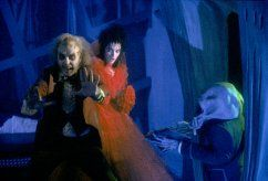 Winona Ryder, Michael Keaton, and Tony Cox in Beetlejuice (1988)