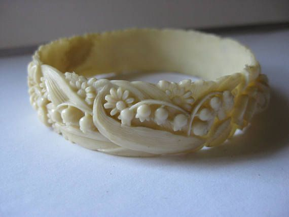 pretty lily of the valley and chrysanthemum carved celluloid bracelet .