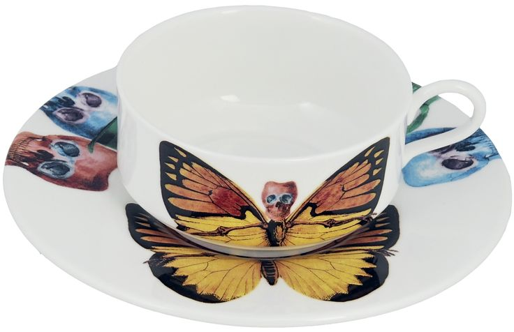 'Croceus' Mocha Cup & Saucer taken from the 'Lepidoptera' range designed by Maxim from The Prodigy. Based on imagery drawn from his wonderful paintings, this range features an array of unusual creatures. Butterfly design on cup continues onto saucer. Saucer also features edgy skulls taken from each six designs. Rear of mocha cup features a 22kt gold butterfly detail. Fine Bone China. Made in Stoke-on-Trent, England.