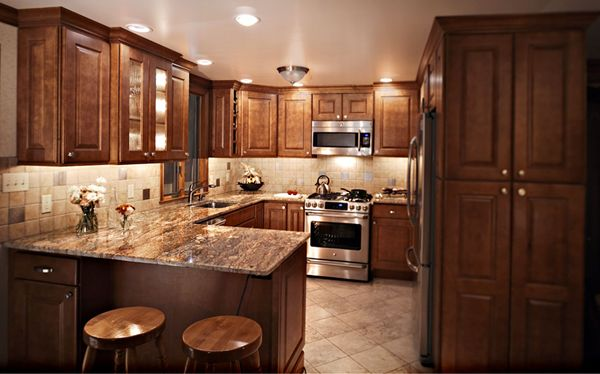 Kitchen layout especially like the penisula bar area for for Split foyer kitchen ideas