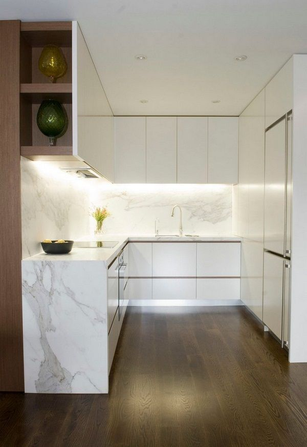 Kitchen and small white handle-less fronts LED halogen form splash marble look