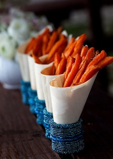 Sweet potato fries in parchment cones in napkin rings! Great party appetizers
