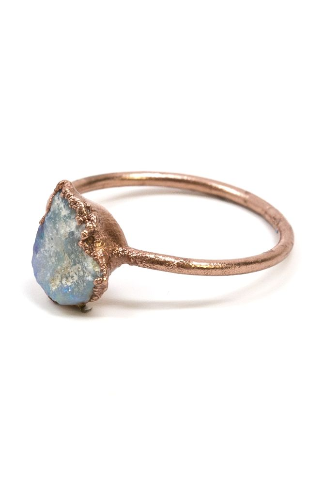 The opal against the copper really makes it shine. I'd wear it with a couple of the smaller version stacked.