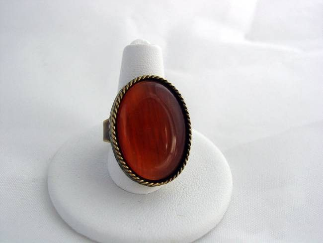 """This inspired ring is done in antique brass/gold tone with roped edges and beautiful engraving work Red Orange carnelian stone, which measures 3/4"""" x 1"""", shimmering tones of light orange to deep carne"""