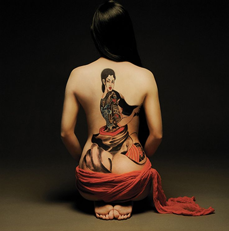 beautiful geshia design asian tattoo on a girls back.For more cool and amazing tattoos, visit www.tattooenigma.com.
