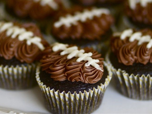 Sports Cakes -- Football cupcakes (could use green frosting & the grass decorating tip around the edges so that the top is covered in frosting & it will look like the football is in the grass)