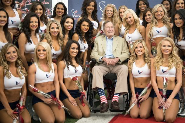 George Bush with Houston Texans Cheerleaders by Smiley N. Pool