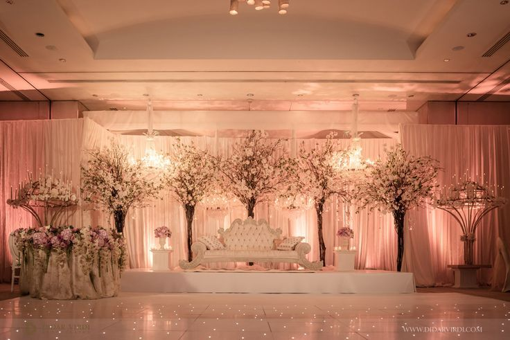Elegant and Romantic Indoor Wedding Reception | Pink Uplighitng | Floral Backdrop
