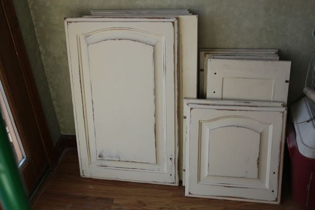 Annie sloan paris grey kitchen cabinets distressed for Annie sloan painted kitchen cabinets