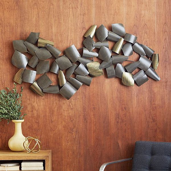 (toilet paper rolls spray-painted?) Curved wall art in metallic tones