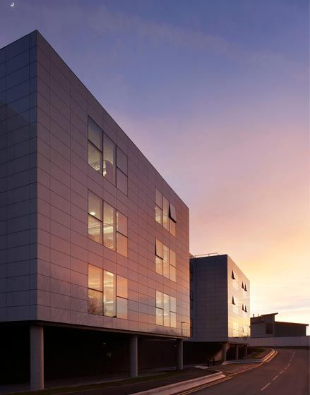 New Ward Block, The Manser Practice #cladding #ceramic #granite #stone #panels #modern #clean #simple #minimal #minimalist #modern #modernist #hospital #healthcare #hospital building #clean #flush #reflective