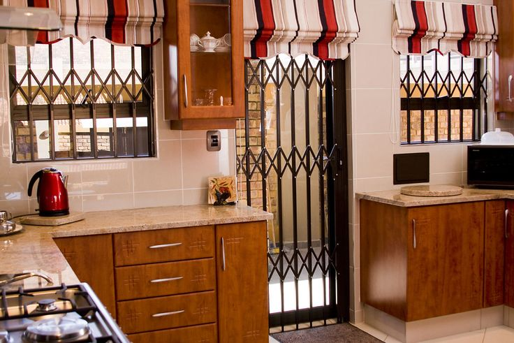 Robo Door builds and installs all types of burglar bars for homes and businesses.  Contact us for all your burglar proofing needs.  www.robodoor.co.za