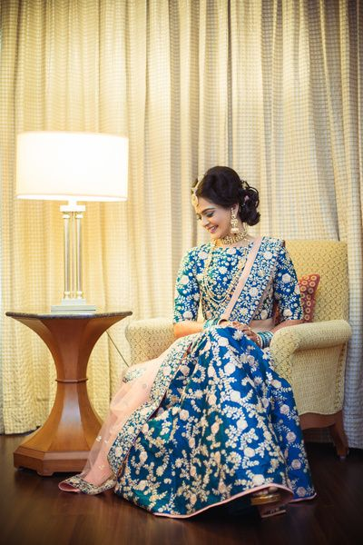 Sangeet Lehengas - Bride in a Royal Blue Lehenga with Golden Embroidery and a Light Pink net Dupatta |