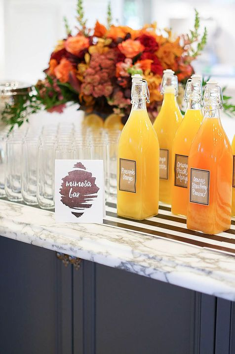 Homegating Mimosa Bar Ideas! Images and paper products: Page and Mason | Styling: Victoria Canada of Victoria Canada Weddings and Events | Floral: Camelback Flowershop #homegating #mimosas #mimosabar #entertaining #footballparty #football #partyideas