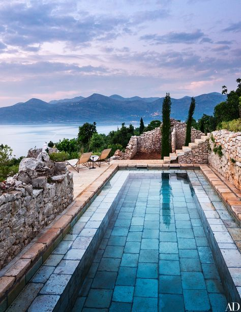 On a Croatian island in the Adriatic Sea, a stone-paved pool by David Kelly of Rees Roberts Partners melds seamlessly with the property's centuries-old walls.