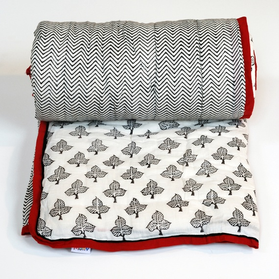 I like the idea of a pure black and white quilt with a red binding...