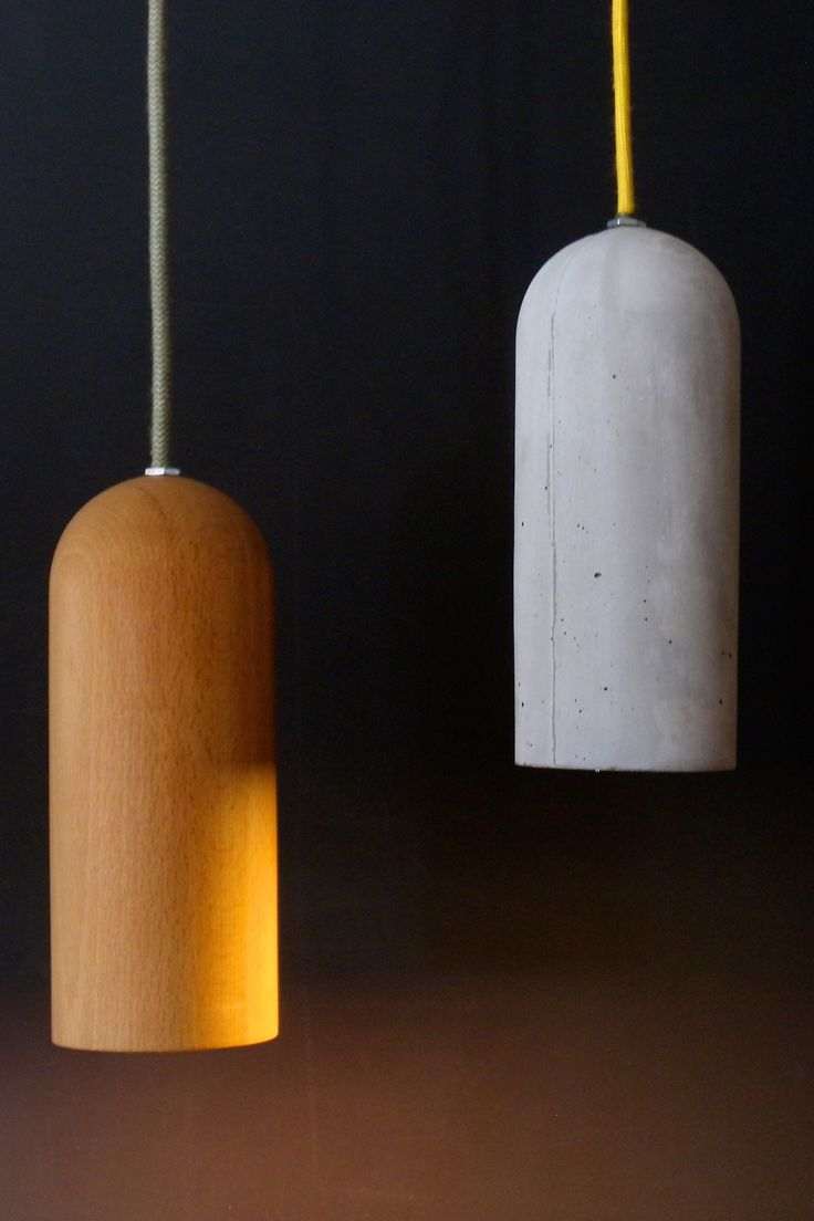 Vessel. Hand made pendant lamps from wood and concrete