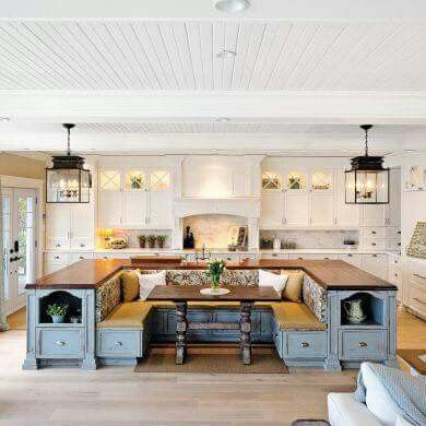 Beautiful kitchen with bench style table backed with counter tops...ahhh I want it!