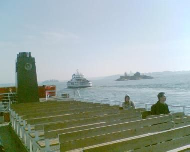 Ferry boat, with the return ferry going past in the background