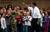 US Republican presidential candidate Mitt Romney waves to elementary students at Fairfeild Elementary in Fairfield, VA, October 8, 2012 during an unscheduled stop. AFP PHOTO/Jim WATSON (Photo credit should read JIM WATSON/AFP/GettyImages)