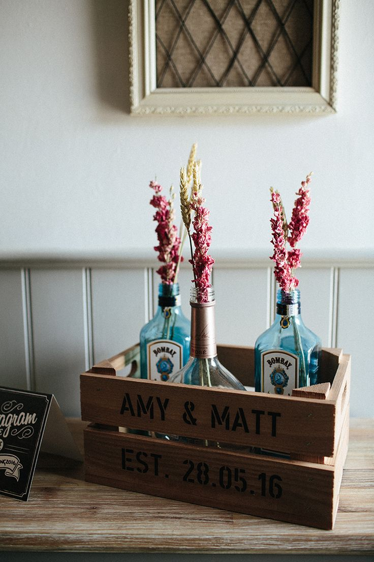 Gin Bottle Dried Flowers Wheat Crate Decor Soft Springtime Countryside Wedding http://www.claudiarosecarter.co.uk/