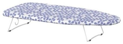 Cheap Ikea portable tabletop ironing board takes up much less storage space than a standard model. Could work in the WIC or sewing area.