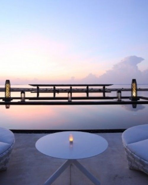 Colossal statues tower over infinity pools and ponds at the Mulia Resort in Nusa Dua. #Jetsetter