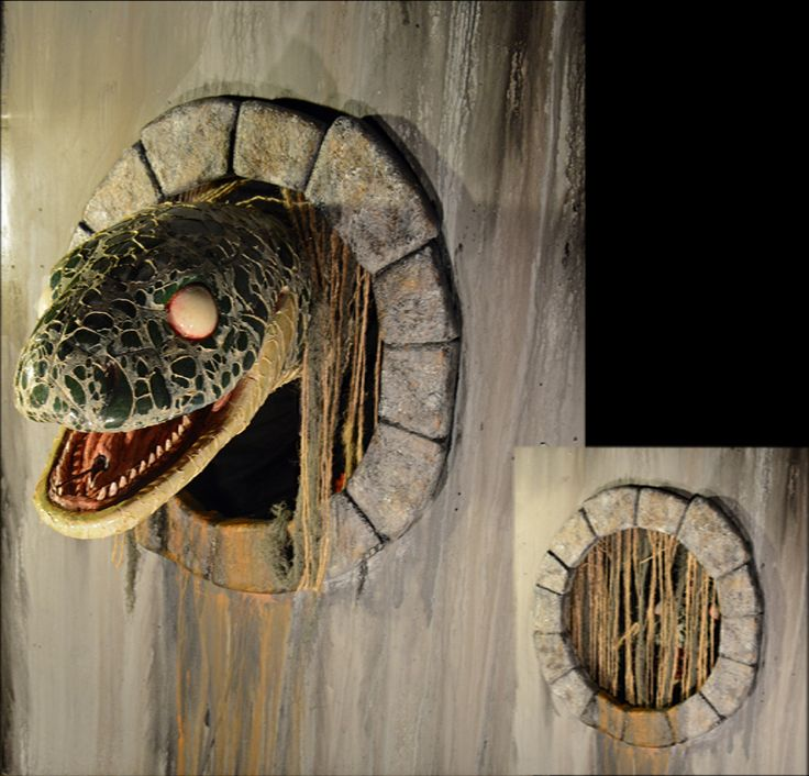 giant sewer snake waits inside sewer hole then shoots out of hole while blasting air at patrons this can easily also be used as a dinosaur creature as wel