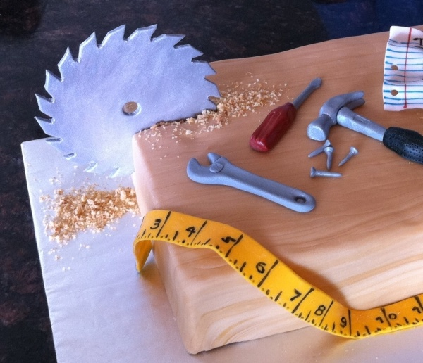 Tool cake inspiration - for the bebo. LOVE the saw blade stuck in the cake! shredded coconut for the sawdust?