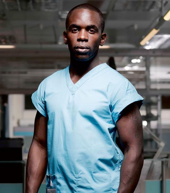 Jimmy Akingbola as irrepressible beefcake, Dr Malik!