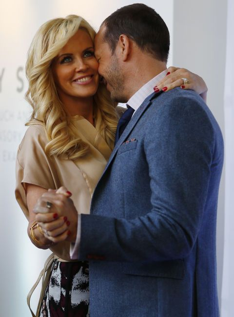 Jenny McCarthy and Donnie Wahlberg. See the 40 other cutest celebrity couple PDA moments.