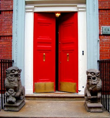 According to the aesthetics of feng shui, a red door symbolizes the mouth of the home and draws positive energy to it. This door is at 16 East 81st Street.