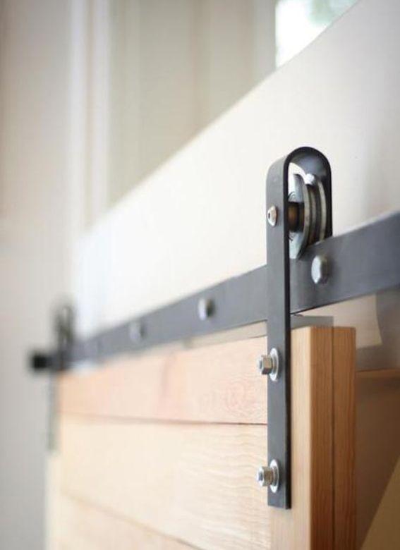 Save space with barn-style sliding doors.  [Hardware - barn door fixtures #door #doors]
