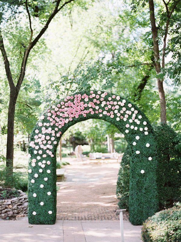 Garden wedding ceremony decor idea - greenery wedding ceremony arch with pink flowers {Pearl Events Austin}