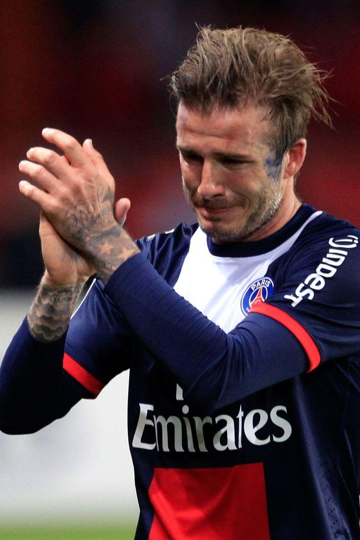 A teary David Beckham leaves the pitch after his final football match for Paris Saint Germain at the Parc de Princes stadium in Paris.