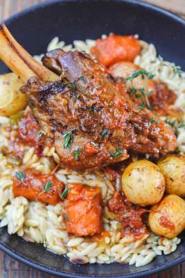 Mediterranean-Style Wine Braised Lamb Shanks Recipe   The Mediterranean Dish. Braising and slow cooker instructions included! Spiced lamb shanks cooked in a red wine and tomato sauce with vegetables, aromatics and fresh herbs! A family favorite for Easter or your next special dinner! See it on TheMediterraneanDish.com
