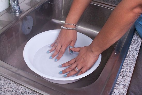 Submerge wet nails in cold water for 3 minutes. The polish will dry completely, and it gets rid of any that got onto your skin!.... wow. why haven't i ever heard of this.
