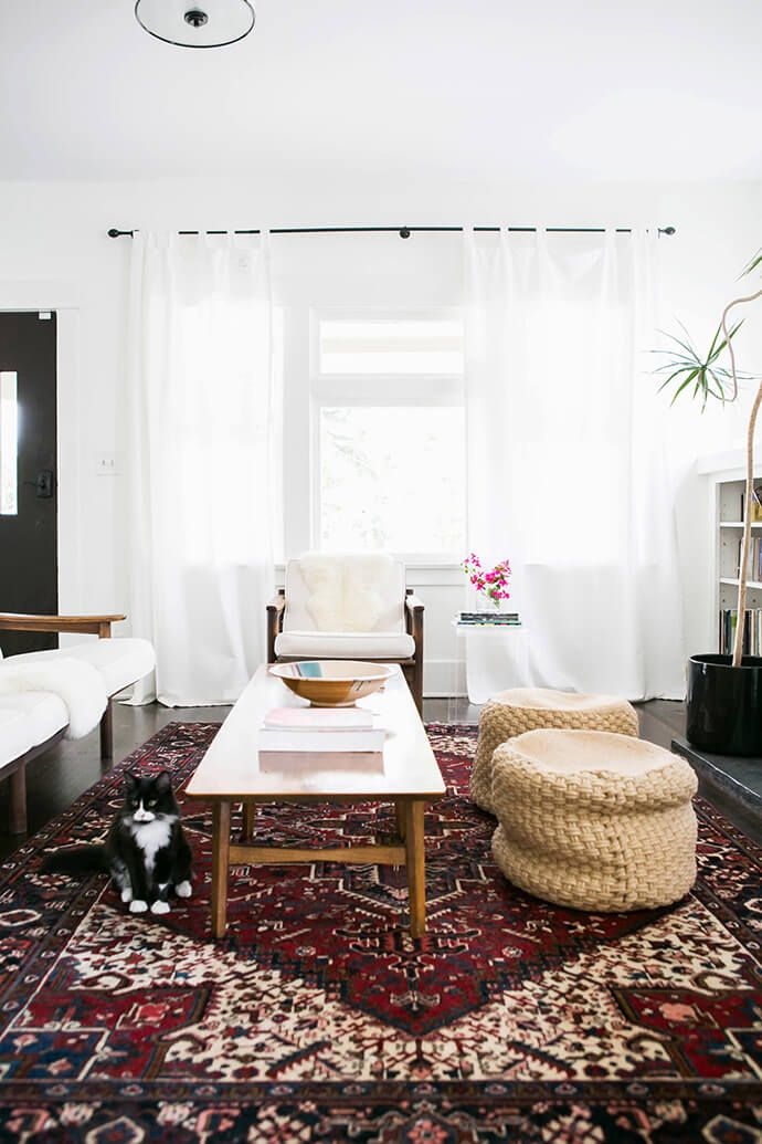 Statement rug in a simple and bright living room.   Glitter Guide