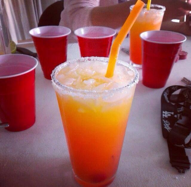 Twisted Tequila Sunrise | 1 1/2 oz. (45ml) Tequila, 2 oz. (60ml) Orange Juice, 2 oz. (60ml) Pineapple Juice, Splash Grenadine, Salt Rimmed Glass, Cherry