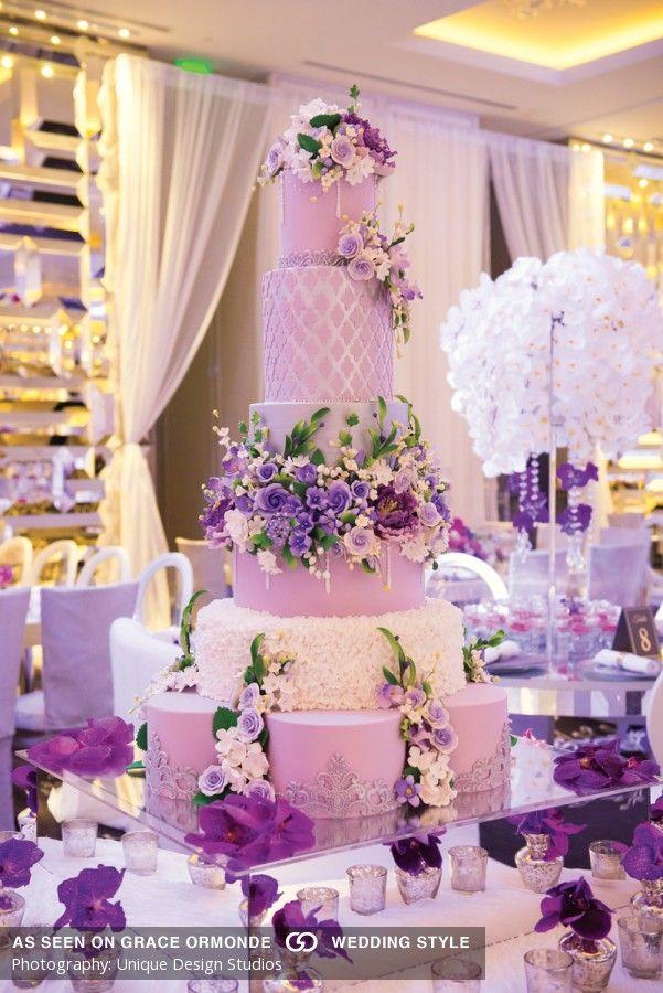 lavish purple wedding cake idea with flowers