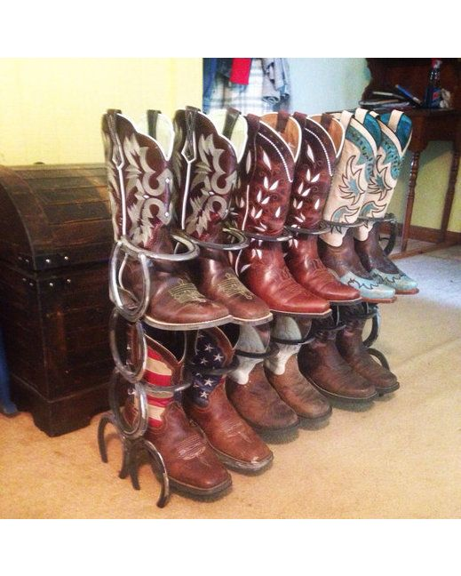 Rustic 6 pair double row boot rack made from horseshoes.  http://www.countryoutfitter.com/products/88568-double-row-horseshoe-boot-rack-raw-metal