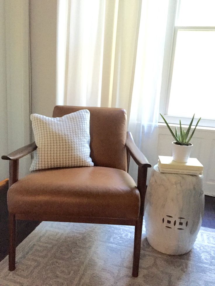 West Elm Chair, midcentiry, garden stool, gray white pillow, pottery barn braylin rug, pottery barn cameron drapes, white curtains, aloe plant, decorating with books, eclectiv living room, gray rug, grey rug, marble decor, decorating on budget, budget decorating, DIY, home decor, living room decor