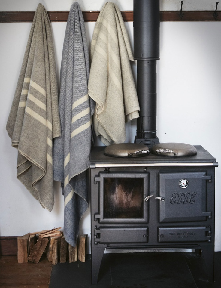 Wool blankets and wood stove fireplace.  I like the idea of a spot to hang and dry stuff near the stove.