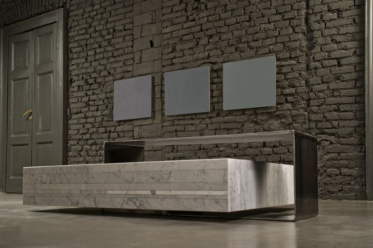 Ta_Volo is a low square coffee table designed by Franz Siccardi for Salvatori in Bianco Carrara Lithoverde, the groundbreaking recyled stone product.