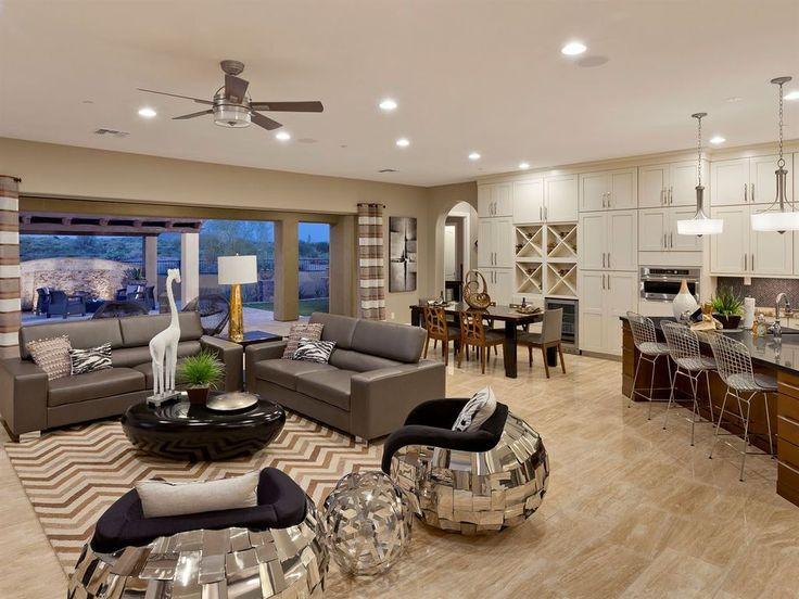 Transitional Great Room with Ceiling fan, flush light, Pendant Light, sandstone tile floors, Built-in bookshelf, Carpet