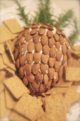 I made two of these for a woodland themed baby shower, it's very good and easy...Pinecone Cheeseball. - use almond slivers instead of whole almonds