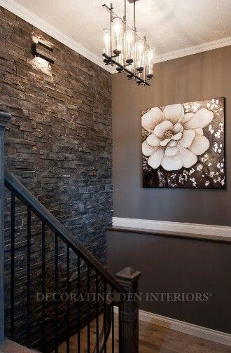 Idea for finishing the basement. Stone wall (like at eNails), iron railing, white trim, dark walls.