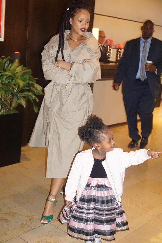 12f6b7a74 Rihanna - Steps out with her goddaughter on in 2019   LUV BUG   Rihanna,  Faux fur hoodie, Fashion