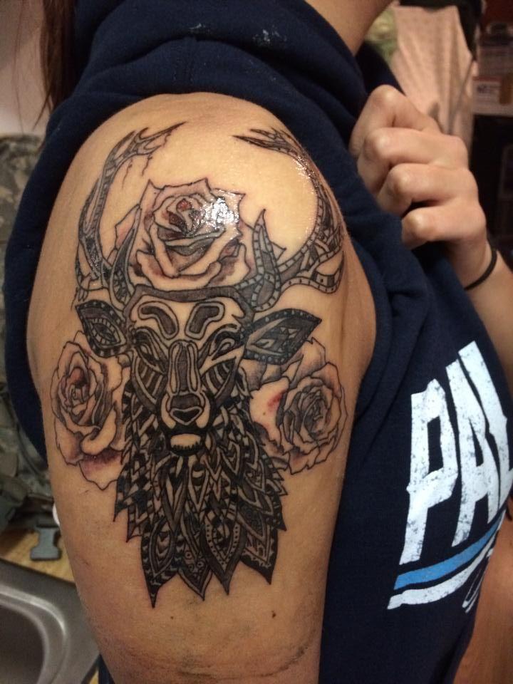 Deer tribal shoulder tattoo